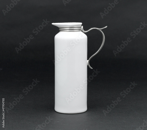A porcelain pitcher for milk, syrup or water