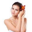Skincare of young beautiful woman face with fresh flower