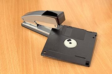stapler and diskette on desk