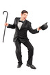 Young performer with cane and hat gesturing