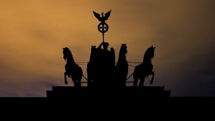 Germany The Brandenburg Gate sculpture night clouds