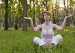 The woman meditates in park