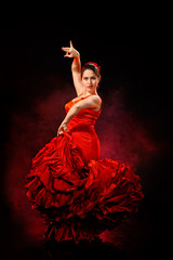 Portrait of  beautiful young woman dancing flamenco