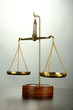 Gold scales of justice on grey background