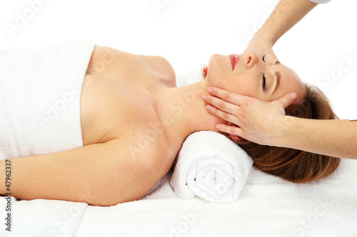 Portrait of beautiful woman taking head massage, isolated