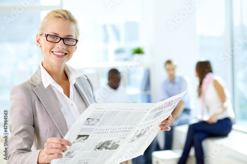 Female reading newspaper