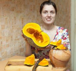 Happy woman cooking pumpkin