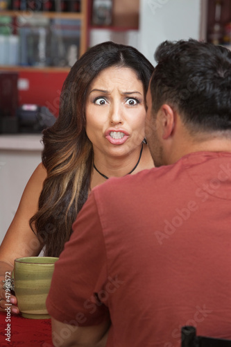 Furious Woman in Coffeehouse
