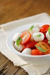 Italian Caprese salad with cherry tomatoes and baby mozzarella