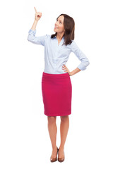 Attractive businesswoman pointing up