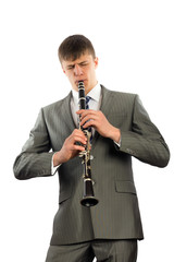 Young musician plays the clarinet