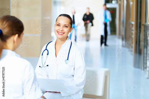 Portrait of two friendly female doctors
