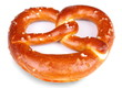 Freshly baked pretzel on white background