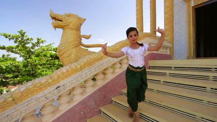 Beautiful Asian Girl performs cambodian folk dance in temple