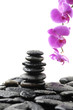 Zen abstract of Stack stones in balance with pink orchid
