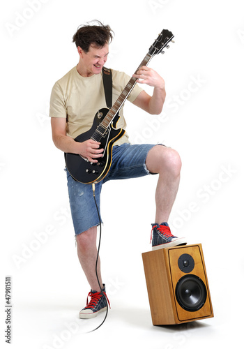 Man in shorts with an electric guitar on white background