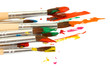 Paint brushes with gouache isolated on white