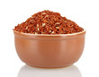 red rice in a brown  plate , isolated on white