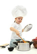 little girl in chef's hat with kitchen accessories, isolated