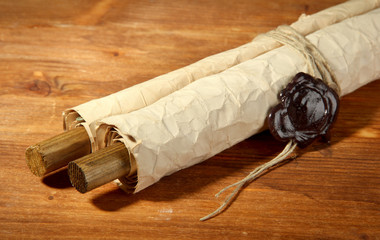 Old scroll, on wooden background