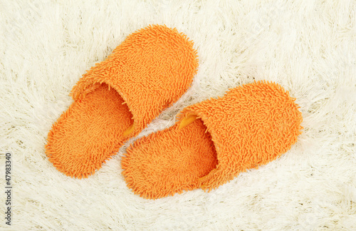 bright slippers, on carpet background