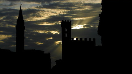 Italy Florence Badia Fiorentina and Bargello sun passing