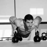 Gym man push-up strength pushup with Kettlebell - 47984523