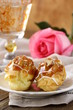 cakes eclair profiteroles on a plate - a dessert for two