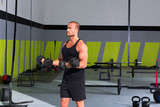Gym man with dumbbells exercise crossfit