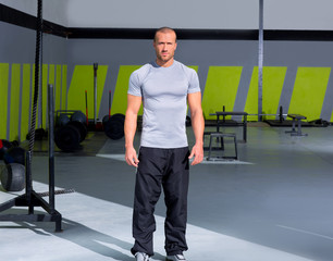 Fitness man at crossfit gym standing