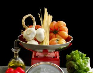 mediterranean diet food  over red kitchen scales