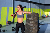 Crossfit sledge hammer woman at gym relaxed