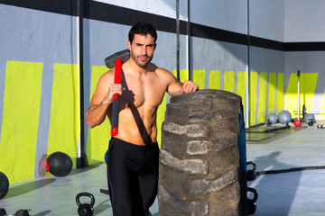 Crossfit sledge hammer man at gym relaxed