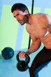 Crossfit man lifting kettlebell workout exercise