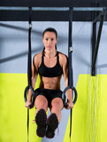 Crossfit dip ring woman workout at gym dipping