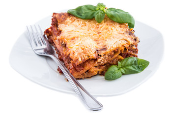 Lasagne on a plate (white background)