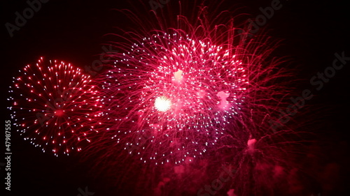 Colorful Firework lights and sound in the night sky in FullHD