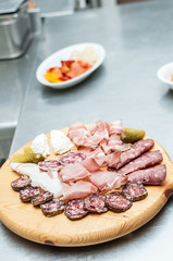 Chopping board with traditional italian appetizers