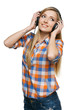 Young female enjoying music in headphones