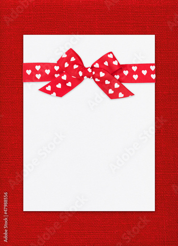 red bow on paper sheet