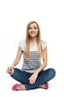 Happy female sitting crossed legs on the floor