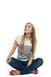 Smiling woman sitting on floor looking up