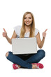 Woman sitting with laptop showing thumb up signs