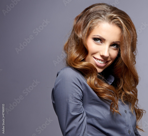 Businesswoman  on grey background