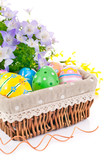 Fototapety easter eggs in basket with spring flowers