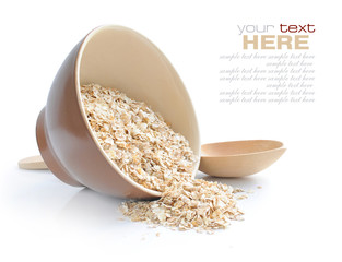 Oat flakes in bowl and wooden spoon on white background