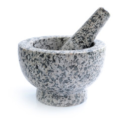 Stone mortar and pestle on white background