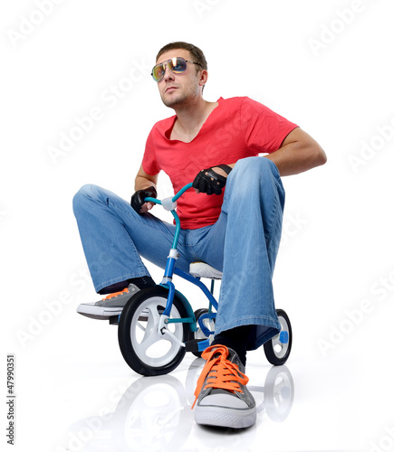 Man on a children's bicycle, on white background