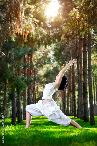 Yoga warrior pose in the park