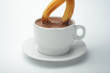 Chocolate en taza con churro